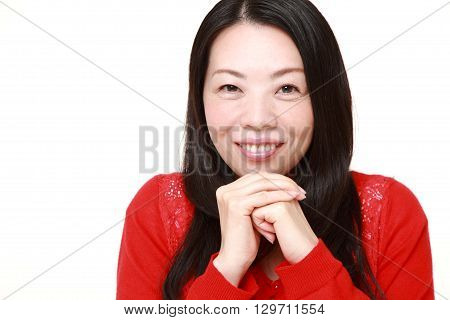 portrait of Japanese woman pleased on white background