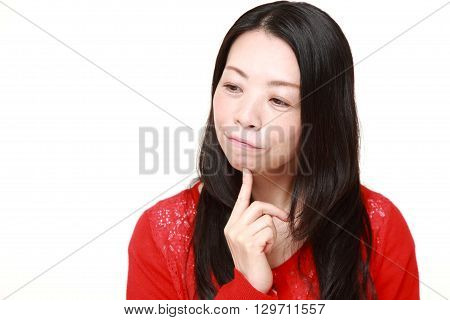 portrait of Japanese woman worries about something on white background