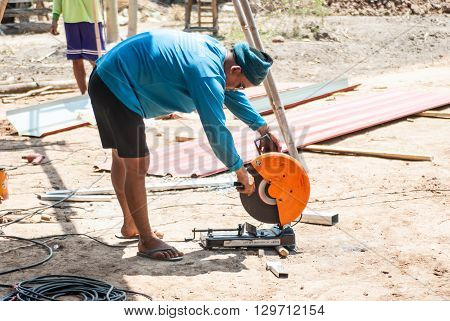 PHITSANULOK - MAY 14: The smith are cutting steel with electric saw. on May 14 2016 in Phitsanulok Thailand.