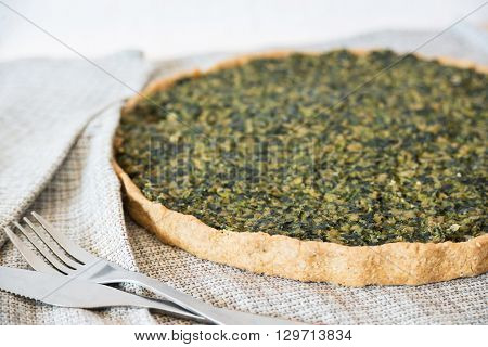 Homemade shortcrust pastry quiche with tofu and spinach