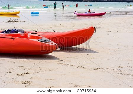 Colorful red kayaks on beach Thailand. boat kayaks