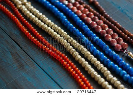 Close up of many prayer beads in a row. Various prayer beads placed together.