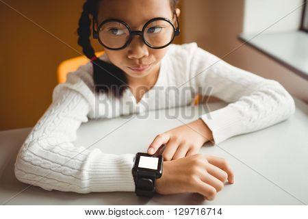Schoolchild wearing a smart watch at school