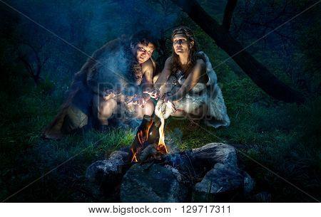 Cave People Near Bonfire