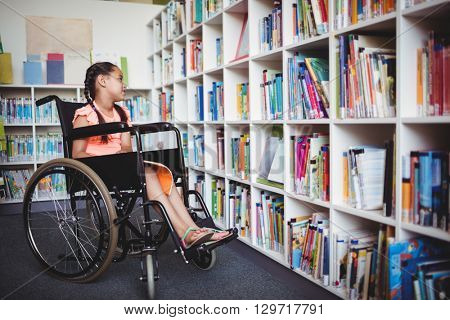 Girl sitting in a wheelchair in the library