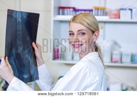 Portrait of woman vet bringing a x-ray at medical office