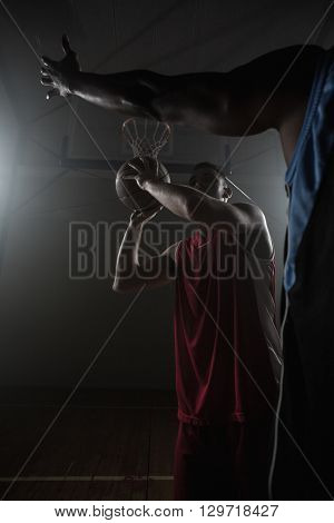 Portrait of men playing basket on a gym