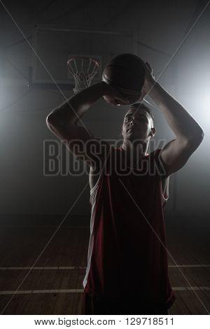 Portrait of basketball player trying to scoring on a gym