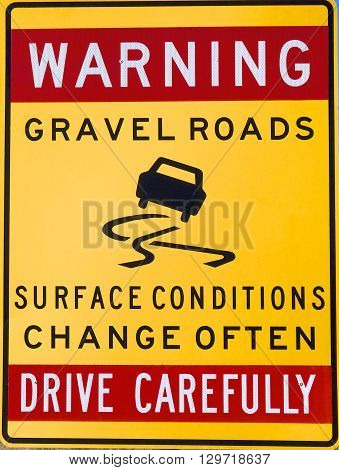 Drive carefully warning sign on a gravel road, Australia