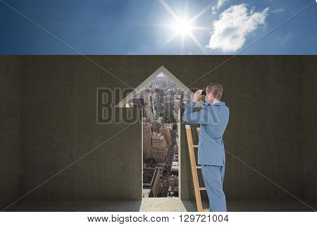 Businessman looking on a ladder against grey room with arrow door
