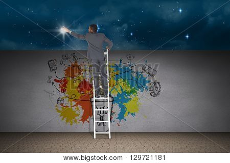 Businessman standing on ladder against stars twinkling in night sky