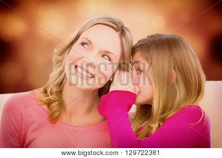 Mother listening to daughter against orange abstract light spot design