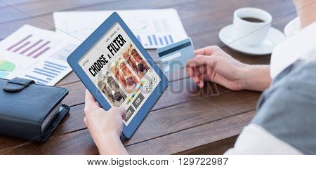 Smartphone app menu against businesswoman using tablet pc and holding credit card