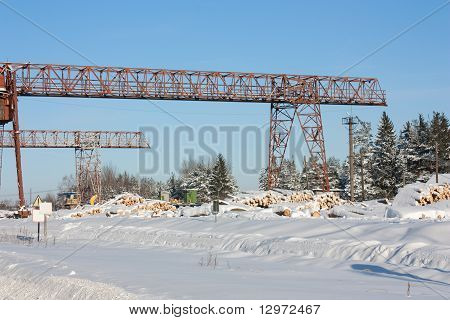 Platform Covered With Snow For Unloading Near A Sawmill
