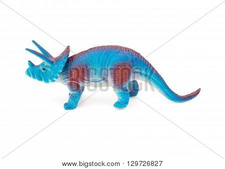 side view blue triceratops toy on a white background