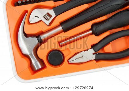 Tool box set containing a hammer pliers screwdriver and removable screwdriver heads.