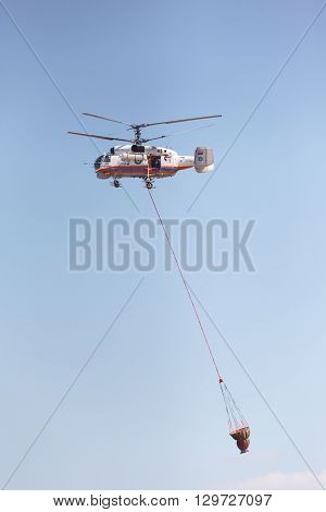 RUSSIA MOSCOW - AUGUST 22 2015: The Helitack Kamov 32A in the sky on doctrines of rescuers of Ministry of Emergency Situations of Russia.