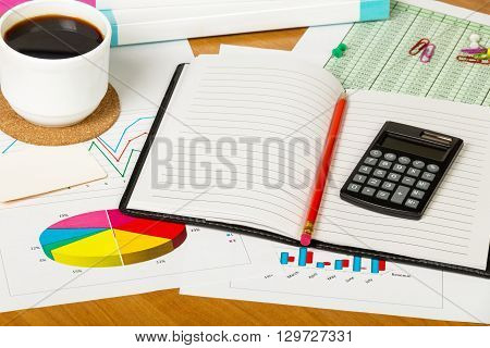 Notepads, pencil and financial documents, office supplies