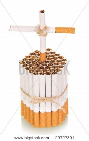 Cross made of cigarettes isolated on white background, concept of harm of smoking