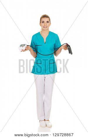Shocked nurse or doctor with pressure gauge