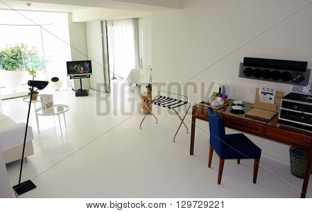 HERAKLION CRETE GREECE - MAY 13 2014: The Interior of light room with table and radio in modern building of luxury class hotel on the Mediterranean coast of Crete, May 13, 2014, Greece.