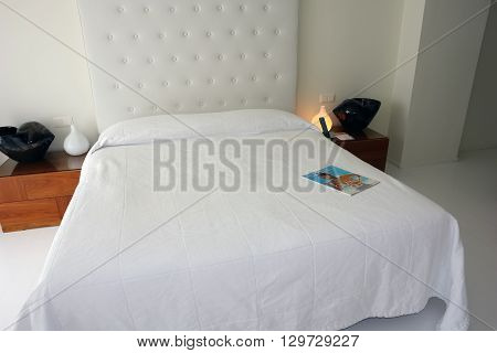 HERAKLION CRETE GREECE - MAY 13 2014: The Interior room with big white bed in modern building of luxury class hotel on the Mediterranean coast of Crete May 13 2014 Greece.