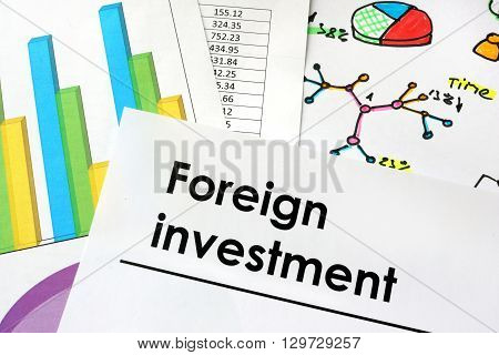 Foreign investment sign written on a paper.