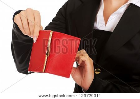 Young woman shows her empty wallet. Bankruptcy concept