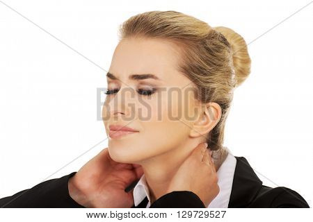 Businesswoman having huge neck ache