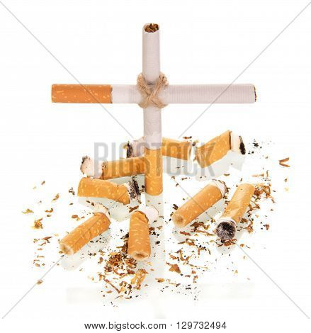 The composition in the form of a cross, and smoked a cigarette isolated on white background