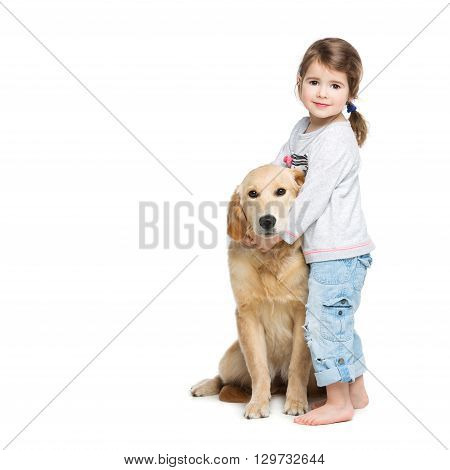 Beautiful little girl hugging golden retriever puppy. Child and dog. Isolated over white background. Copy space.