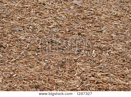 Wood Chips On Playground Floor To Soften Falls Of Children Playi