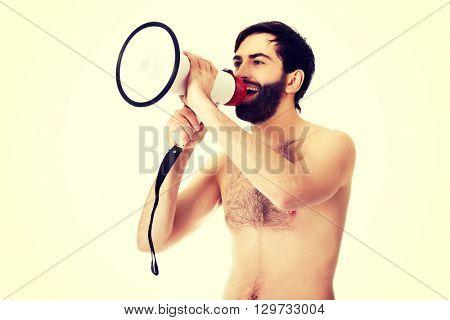 Shirtless man shouting using a megaphone.