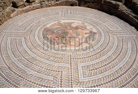 Mosaic floors of ancient roman villas with scenes from Greek mythology - battle of Theseus and Minotaur in labyrinth archaeological park Tombs of Kings,Paphos,Cyprus,unesco heritage