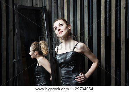 Woman Trying On Dress In Front Of Mirror