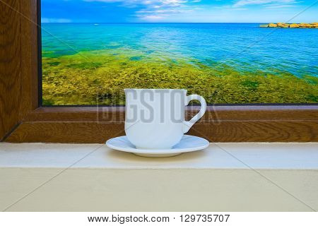 Cup Of Coffee On The Window