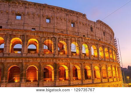 detail of Colosseum illuminated at night  in Rome, Italy, toned