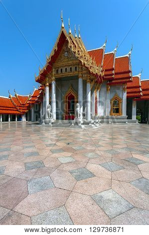 The Marble Temple with reflection under the blue sky Wat Benchamabopitr Dusitvanaram (Bangkok Thailand)