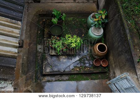 top view outdoor house after raining with wet earthen water jar