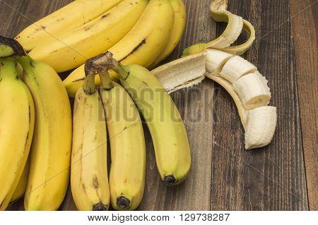bananas on the table , peeled banana, sliced banana