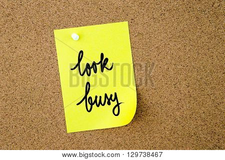 Look Busy Written On Yellow Paper Note