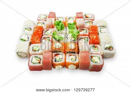 Japanese food restaurant, sushi maki gunkan rainbow roll plate or platter set. California Sushi rolls with salmon. Sushi isolated at white background.