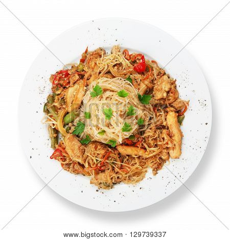 Asian food. Fried Thai Rice noodles with meat and vegetables. Chinese rice vermicelli with meat, parsley and peppers. Top view, flat lay, isolated