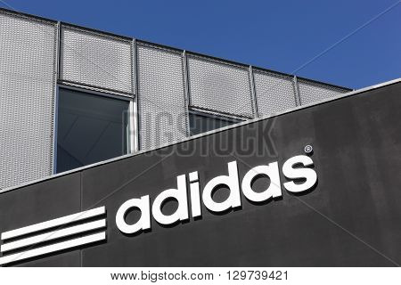 Aarhus, Denmark - May 1, 2016: Adidas logo on a wall. Adidas is a German multinational that manufactures sports shoes, clothing. It is the second biggest sportswear manufacturer in the world