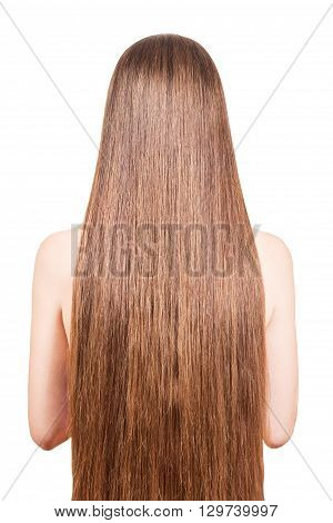 The girl with well-groomed, smooth, long, brown hair isolated on white background