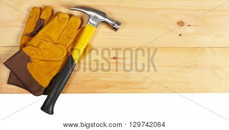 Hammer And Gloves Wrench On Wooden Background