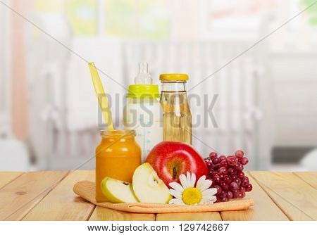 Healthy baby food in the kitchen background