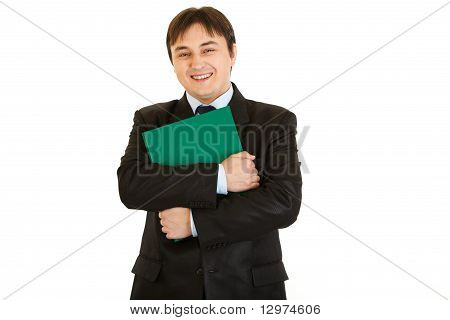 Smiling businessman hugging folder with documents isolated on white