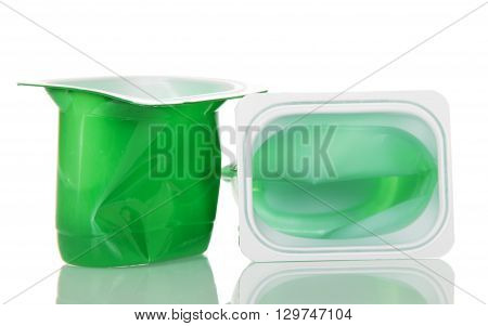 Empty plastic cups with yogurt close up isolated on white background.
