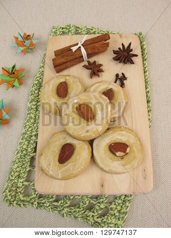 Gingerbread biscuits with sugar icing and almonds